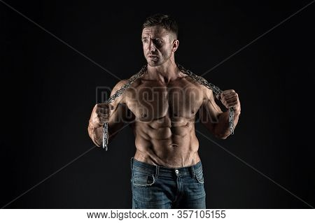 Intensity Builds Immensity. Athlete With Metal Chain Black Background. Strong Athlete With Six Pack