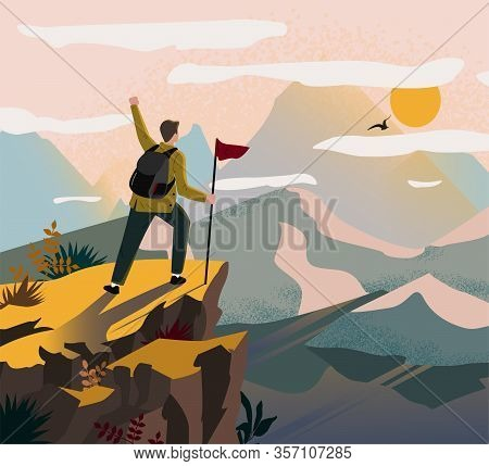 A Traveler Man On Top Of A Mountain With A Backpack And A Flag Triumphantly Raised His Hand And Look
