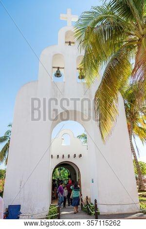 Playa Del Carmen, Mexico - Dec. 26, 2019: Tourists Visit The Parish Of Our Lady Of Carmen, Or Parroq