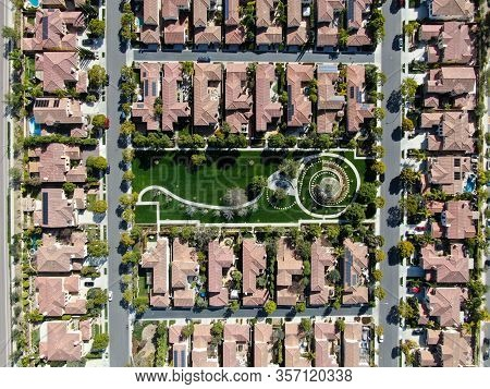 Aerial Top View Suburban Neighborhood With Identical Villas Next To Each Other. San Diego, Californi