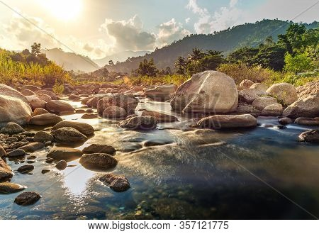 River Stone And Tree With Sun Beam, View Water River Tree, Stone River And Sun Ray In Forest