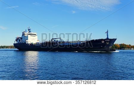 Alexandria Bay, New York, U.s.a - October 24, 2019 - A Large Ship Passing By St Lawrence River And T