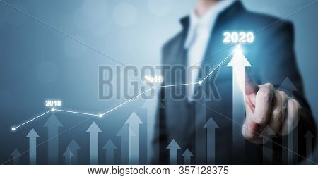 Business Development To Success And Growing Growth Year 2020 Concept, Businessman Pointing Line Dot