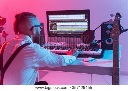 Musician And Making Music Concept - Male Sound Producer Working In Recording Studio.