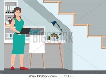 Young Professional Woman Working From Home At Her Desk At Home.  Workplace With A Computer Under The