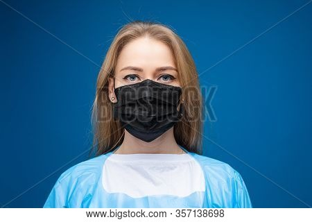 Caucasian Woman In Aseptic Mask. Stop Viruses Concept.