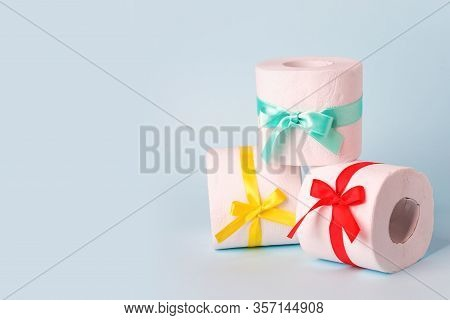 Set Of Toilet Paper Wrapped In A Gift Bow. The Concept Of A Valuable Actual Gift, A Meme On The Defi