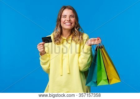 Happy Smiling Pretty Girl Using Her Credit Card, Deposit Money For Shopping, Holding Bags With Cloth