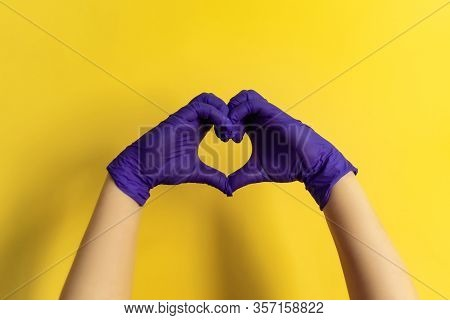 Health Care Employee Showing Heart Sign With Hands, Call For Charitable Donation