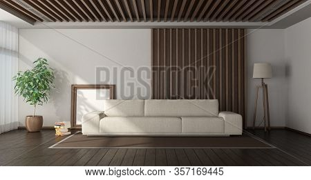 Minimalist Room With White Sofa Against Wooden Paneling On Background, Hardwood Floor And Ceiling Wi