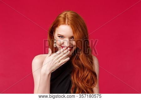 Close-up Portrait Of Gorgeous Silly And Coquettish Redhead Girl Acting, Giggle And Look From Under F