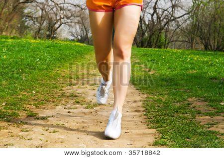 sports girl runs in park