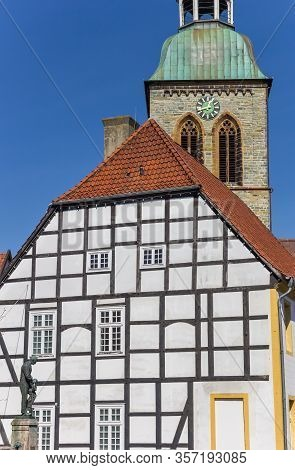 Half Timbered Town Hall And Church Tower In Wiedenbruck, Germany