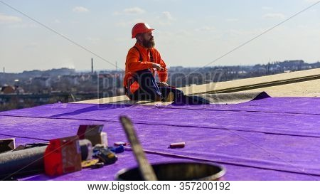 Successful Engineer. Worker Special Protective Work Wear. New Roof Under Construction Residential Bu