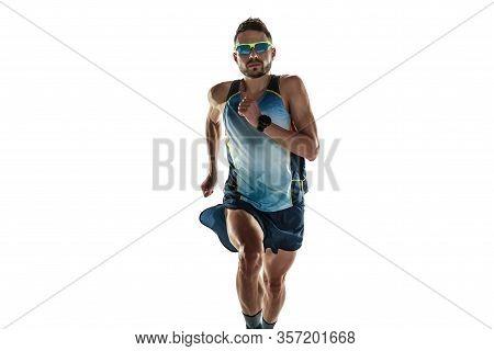Triathlon Male Athlete Running Isolated On White Studio Background. Caucasian Fit Jogger, Triathlete