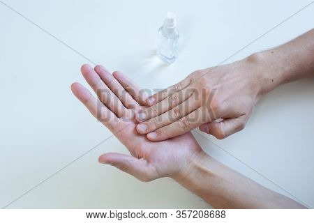 Man Hand Using Wash Hand Sanitizer Gel Pump Dispenser For Protection Coronavirus, Germ And Bacteria,