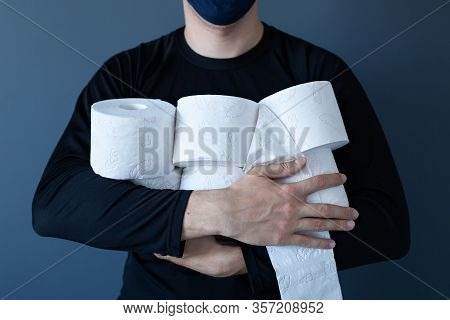 Man Hands Storing Tissue Toilet Paper During Covid19, Concept Quarantine. People Are Stocking Up Toi