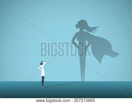 Female Doctor Looking At Superhero Shadow On The Wall. Hospital Staff, Nurses Heroes Fight Coronavir