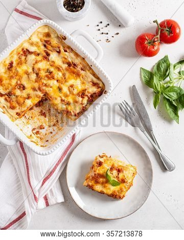 Traditional Italian Lasagna With Vegetables, Minced Meat, Cheese Bolognese And Bechamel Sauce. Top V