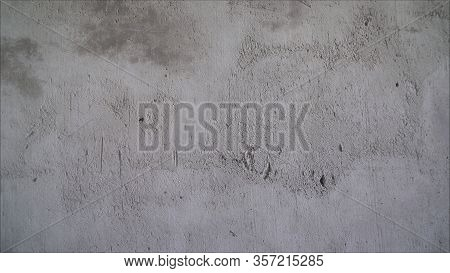 Concrete Wall. Primed Concrete Wall. Repair Work, Priming And Painting A Bare Concrete Wall. Gray Co