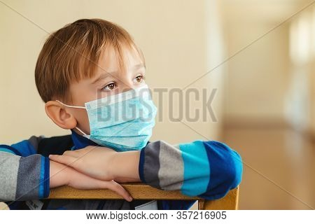 Child Wearing A Protective Face Mask. Face Mask To Prevent Virus Infection Or Pollution. Coronavirus