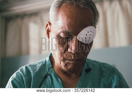 Patient Covering Eye With Protective Shield After Eyes Cataract Surgery In Hospital