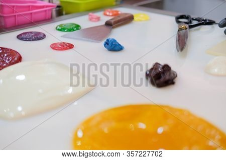 Melted Colored Sugar For Making Candies In Confectionary Candy Shop