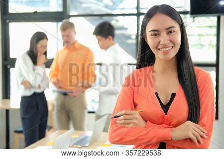 Business People Discussing On Performance Revenue In Meeting. Businesswoman Working With Businessman
