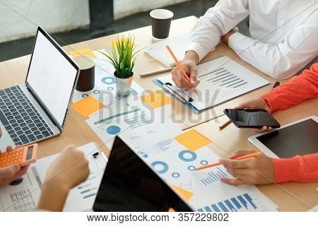 Business People Discussing On Performance Revenue In Meeting. Businessman Working With Businesswoman
