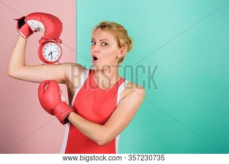 Control Time. Boxer Fighting With Alarm Clock. Time For Boxing Training. Punctuality And Personal Ef