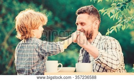 Organic And Natural Food. Small Boy Child With Dad. They Love Eating Together. Weekend Breakfast. Fa