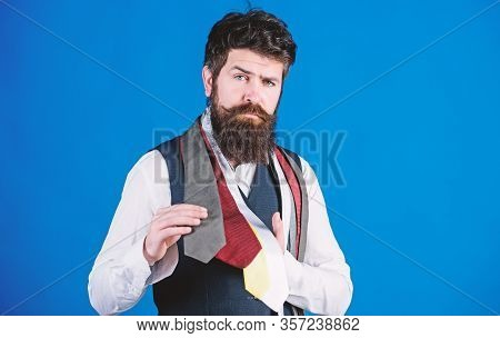It Is A Perfect Choice Neckwear. Salesman Offering A Good Choice Of Design Neckties. Bearded Man Cho
