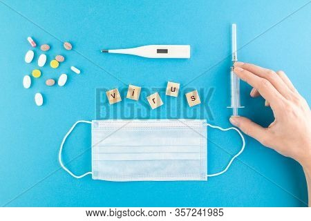 The Inscription Virus Laid Out Of Wooden Cubes On A Blue Background. Medical Concept For Health And