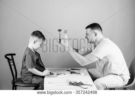 Medical Examination. Medical Service. Man Doctor Sit Table Medical Tools Examining Little Boy Patien