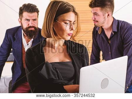 Confident And Smart. Smart Woman Working On Laptop Computer With People In Office. Smart Female Work