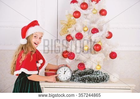 New Year Countdown. Girl Kid Santa Hat Costume Hold Clock Excited Happy Face Expression Counting Tim
