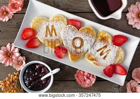 Heart Shaped Pancakes With Mom Letters. Mothers Day Breakfast Concept. Above View Table Scene On A R