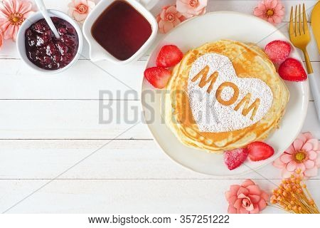 Pancakes With Heart Shape And Mom Letters. Mothers Day Breakfast Concept. Above View Corner Border O