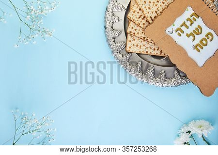 Pesah Celebration Concept - Matzo And Seder Background With White Flowers And Traditional Book With
