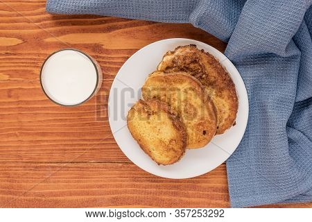 French Toast - Przenice - Slices Of Bread Soaked In Beaten Eggs And Milk And Fried, With A Glas Of Y