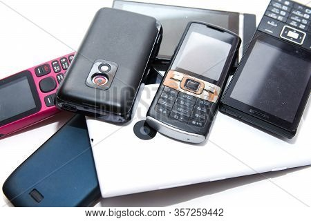 A Bunch Of Old Useless, Non Working, Dirty, Dusty And Rusty Cell Phones.