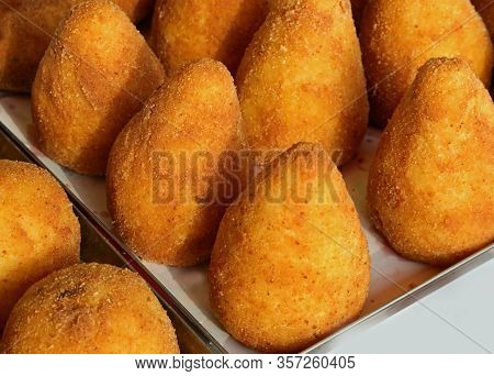 Large Tasty Fried Balls Made With Rice And Peas Called Arancini In The Italian Language