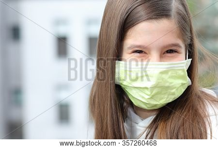Girl With Long Brown Hair Wears A Surgical Mask To Protect Herself From The Terrible And Contagious