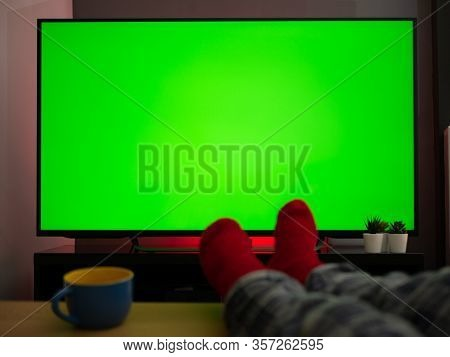 Feet Up On The Table In Front Of Green Screen Tv Televison Chroma Key At Home
