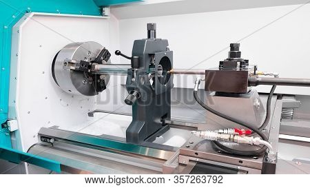 Metalworking  Cnc Industry: Cutting Steel Metal Shaft Processing On Lathe Machine In Workshop.