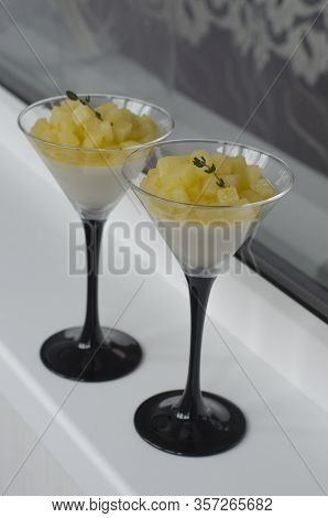 Panna Cotta With Pear And Orange In A Glass