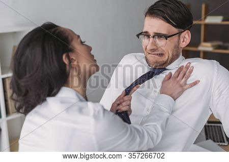 Seductive Businesswoman Touching Scared Colleague While Seducing Him In Office