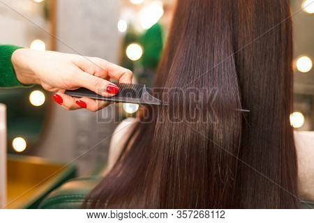 Straight And Shiny Hair After Lamination. Hairdresser Demonstrates The Result Of Keratin Hair Straig