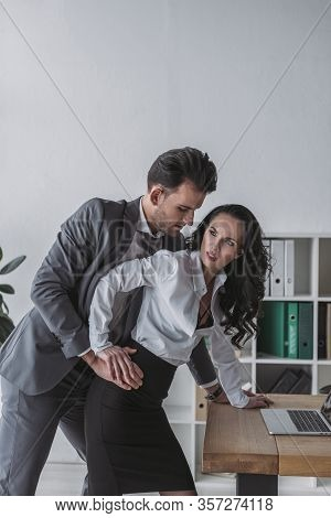 Handsome Businessman Molesting Angry Secretary In Office