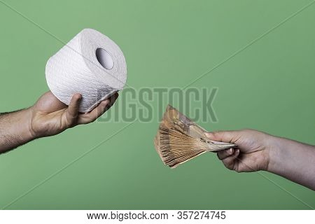 Woman Offering A Stack Of Money For A Roll Of Toilet Paper. Buying And Selling Concept With Toilet P